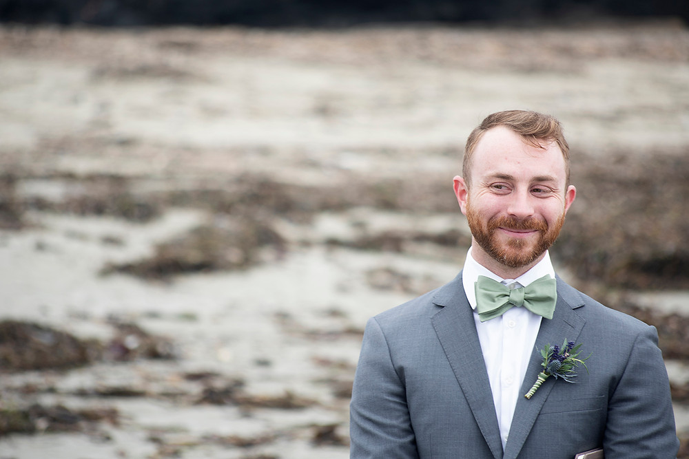 groom at wedding ceremony at Schooner Cove Tofino. Photographed by Kaitlyn Shea