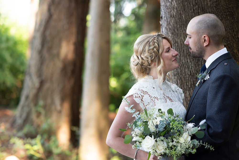 Happy couple in the forest at Sea Cider on Vancouver Island. Photographed by Kaitlyn Shea.