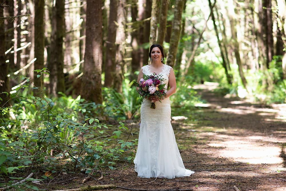 Bride walks to the alter at a Tofino wedding in the forest. Photographed by Kaitlyn Shea.