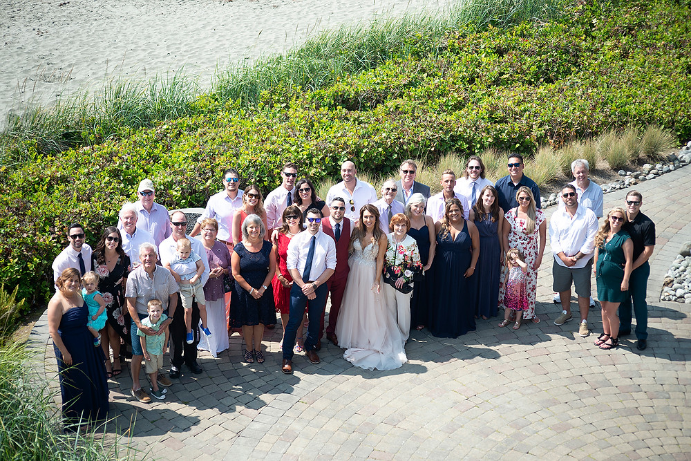 group photo after wedding ceremony at beach wedding in Tofino. Photographed by Kaitlyn Shea