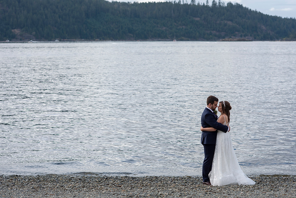 Bride and groom take a moment to themselves at their August wedding on Vancouver Island. Photographed by Kaitlyn Shea.
