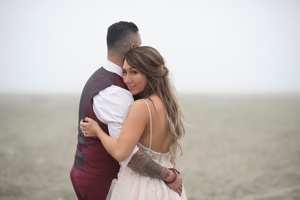 bride hugs groom at Tofino beach wedding at Long Beach Lodge