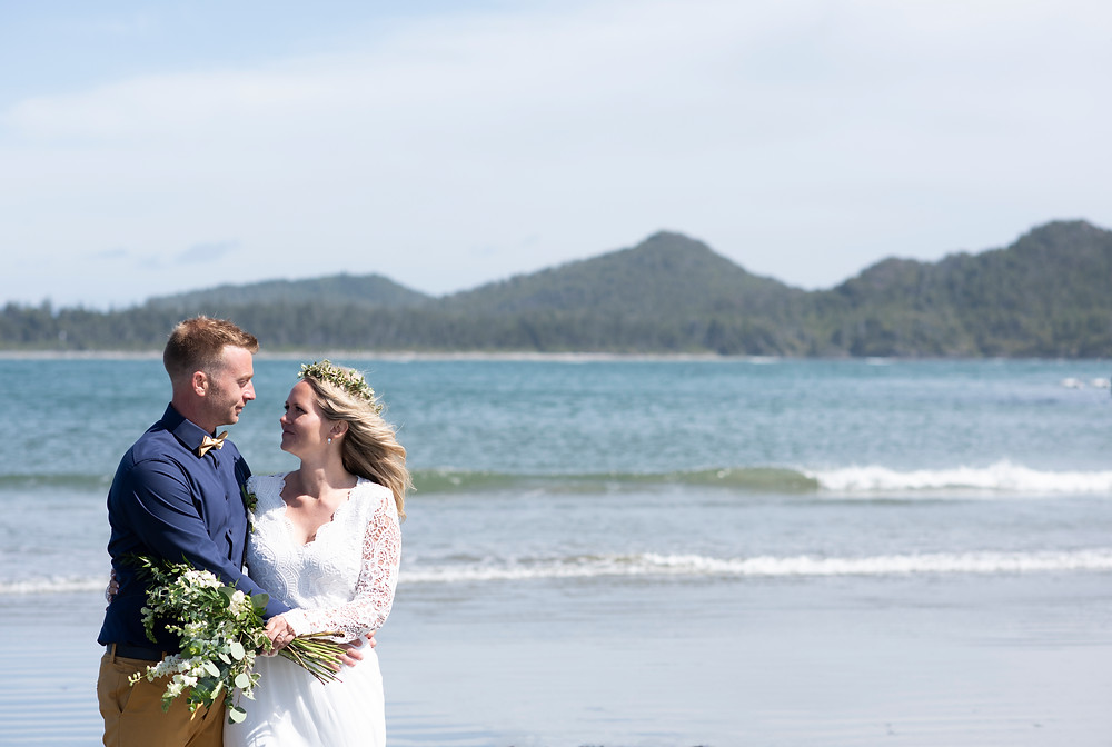 bride and groom on Chesterman Beach Tofino. Photographed by Kaitlyn Shea