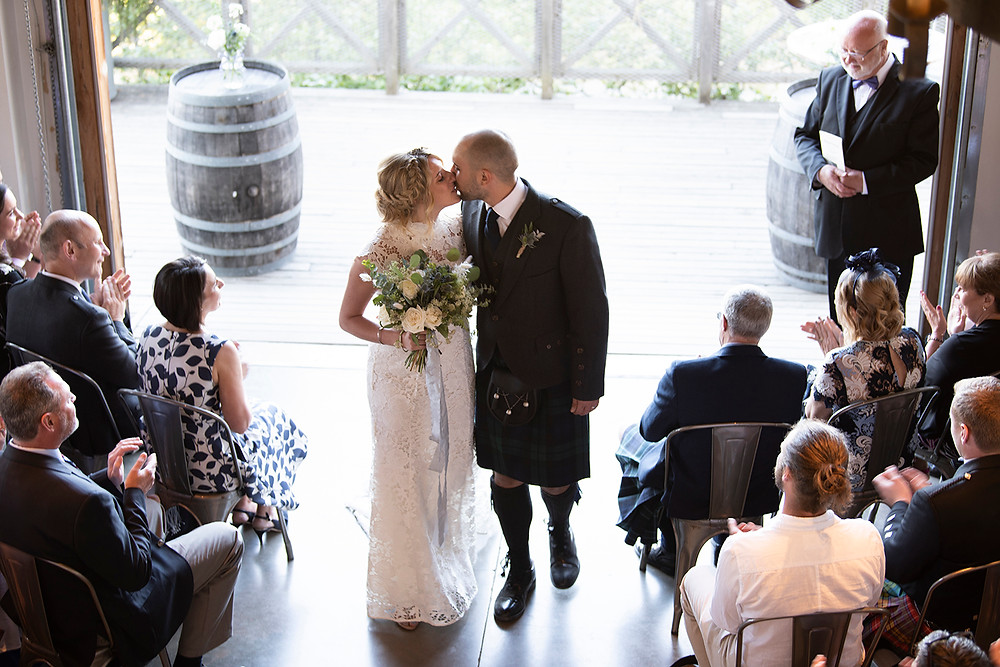 Bride and groom walk down the aisle together at Sea Cider Victoria. Photographed by Kaitlyn Shea.