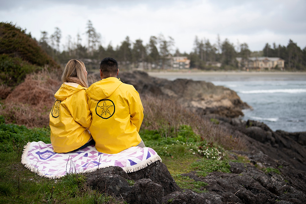 Newly engaged couple looks out over Cox Bay. Photographed by Tofino photographer Kaitlyn Shea.