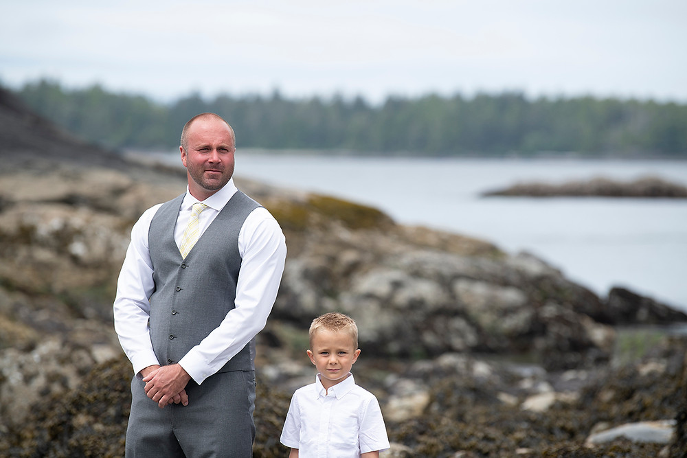 Groom smiles at bride at elopement in Tofino. Photographed by Kaitlyn Shea.