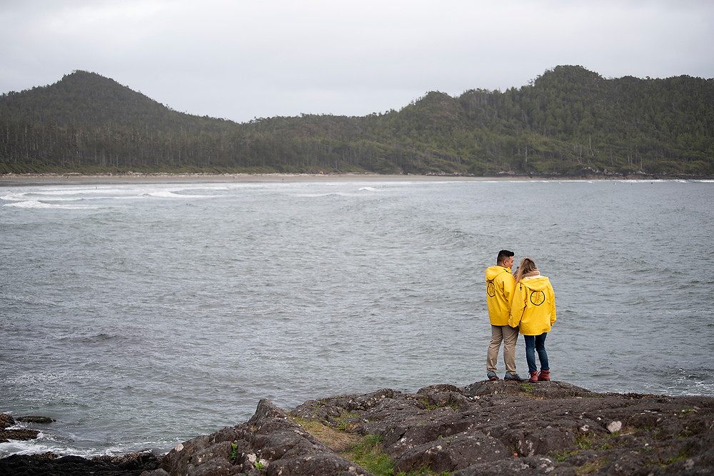 Newly engaged couple stands on Pettinger Point in Tofino. Photographed by Tofino photographer Kaitlyn Shea.