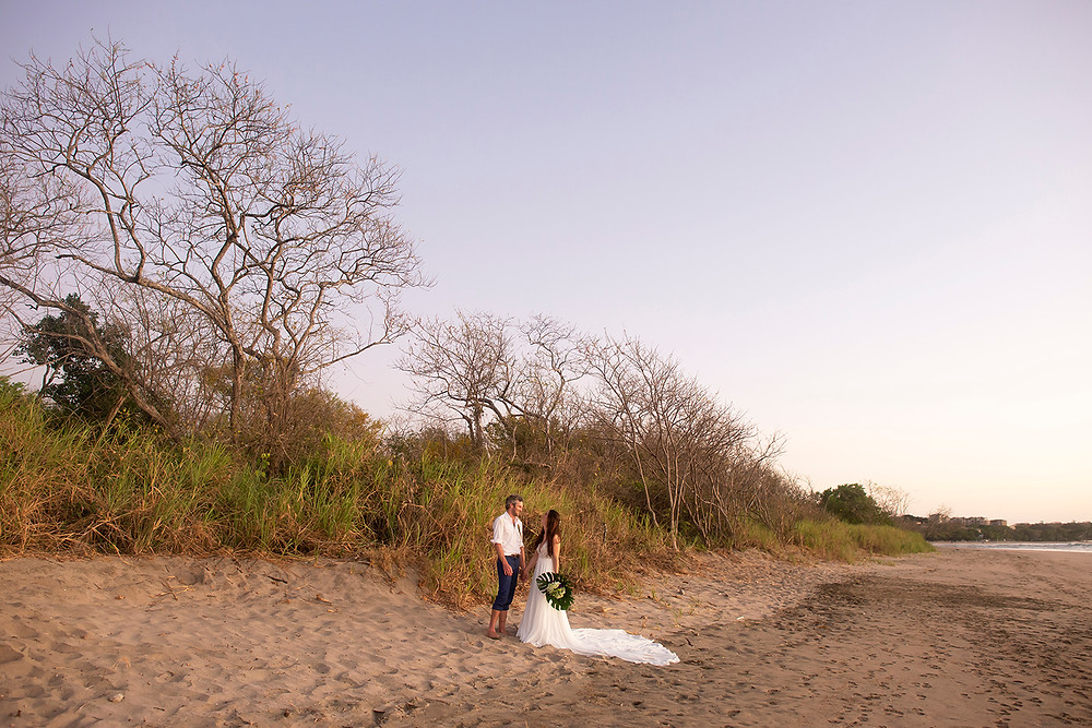 Newly married couple at their destination wedding in Playa Grande, Costa Rica. Photographed by Kaitlyn Shea.