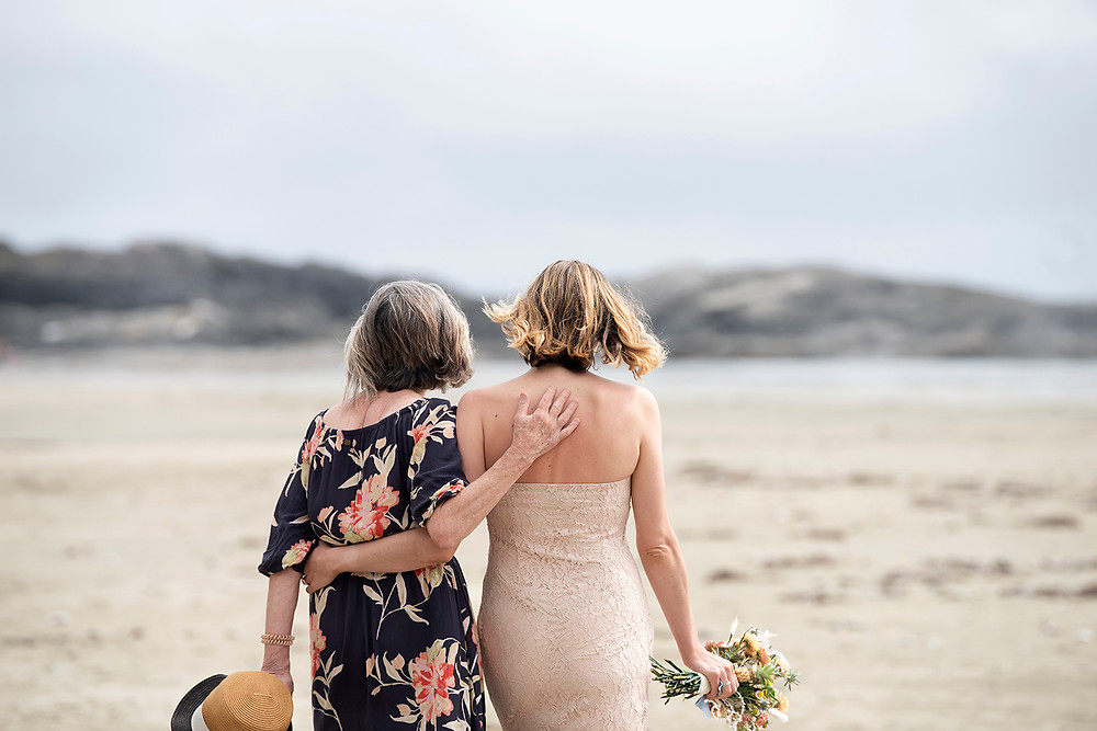 Bride and her mom at Tofino elopement on Long Beach. Photographed by Kaitlyn Shea.