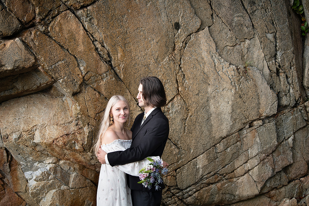 Newly married couple at their Tofino wedding at Tonquin Beach. Photographed by Tofino wedding photographer Kaitlyn Shea.