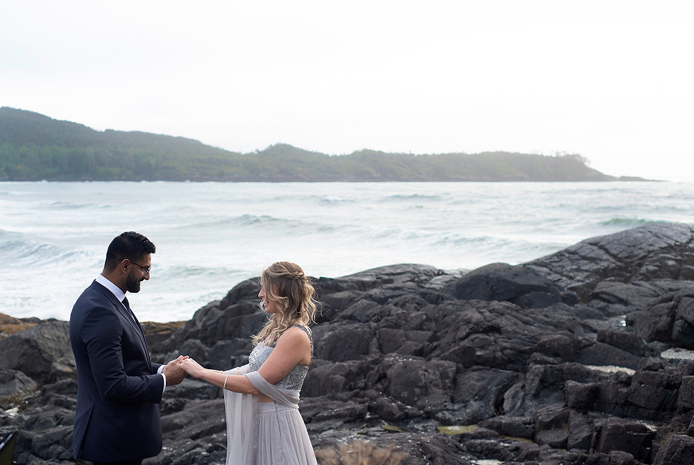 Bride and groom hold hands at their small wedding in Tofino. Photographed by Tofino wedding photographer Kaitlyn Shea.