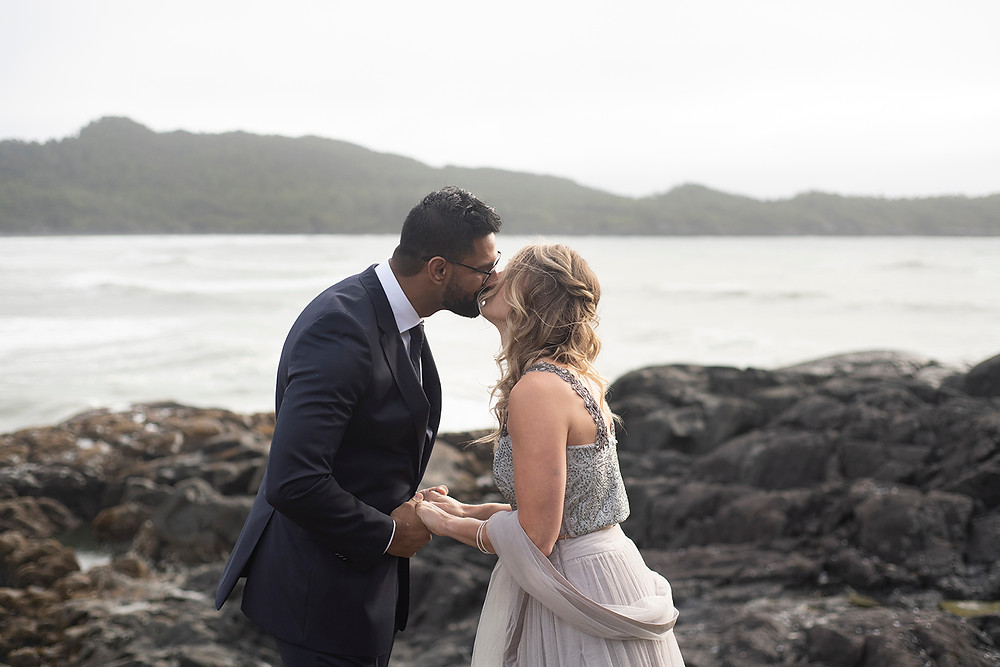 Couple shares their first kiss as husband and wife at their small wedding in Tofino. Photographed by Tofino wedding photographer Kaitlyn Shea.