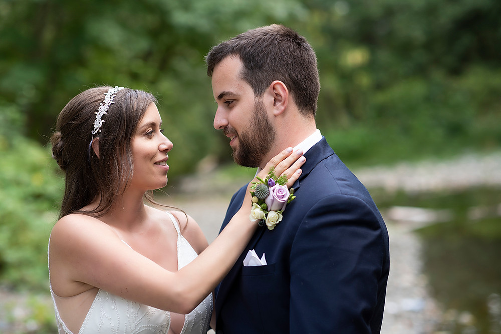 Bride looks at her new husband lovingly at their August wedding on Vancouver Island. Photographed by Kaitlyn Shea.