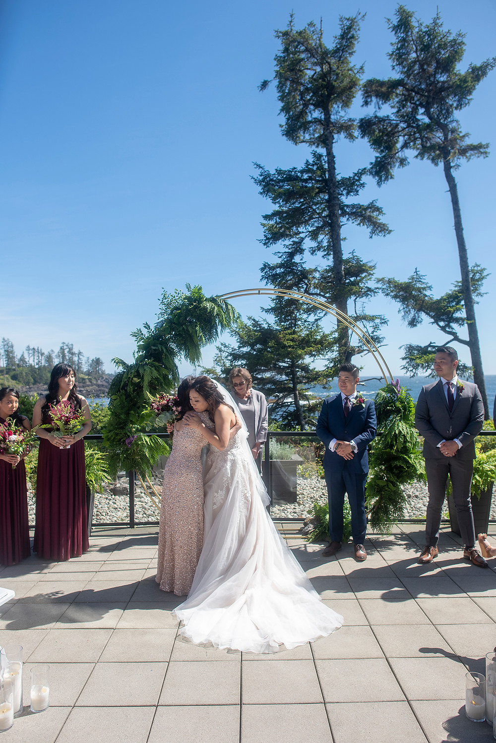 Bride gives mom a hug at her Ucluelet wedding at Black Rock Resort. Photographed by Ucluelet Photographer Kaitlyn Shea.
