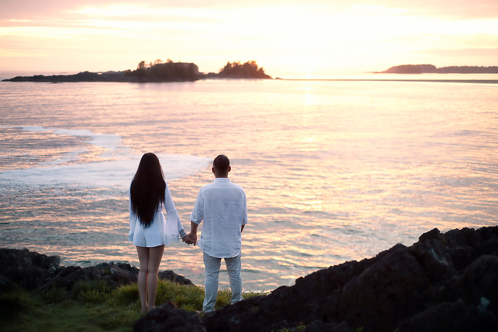 Couple stands on Pettinger Point and admires the sunset after a surprise marriage proposal. Photographed by Kaitlyn Shea.