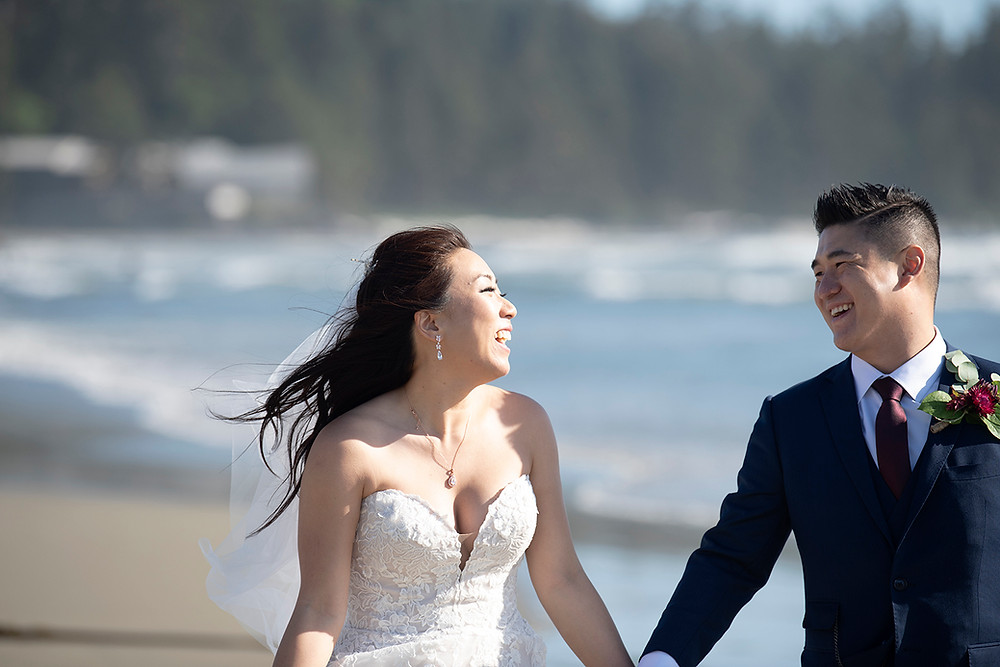 Bride laughing at groom at their Ucluelet wedding at Black Rock Resort. Photographed by Ucluelet Photographer Kaitlyn Shea.