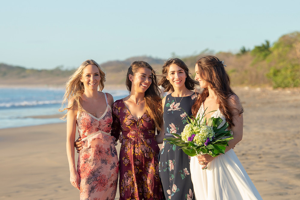 All the girls at a destination wedding on Playa Grande in Costa Rica. Photographed by Kaitlyn Shea.