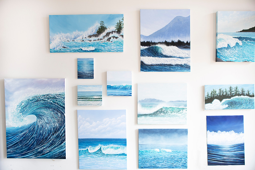 Paintings hang on the wall in Tofino artist Emma Paveley's studio
