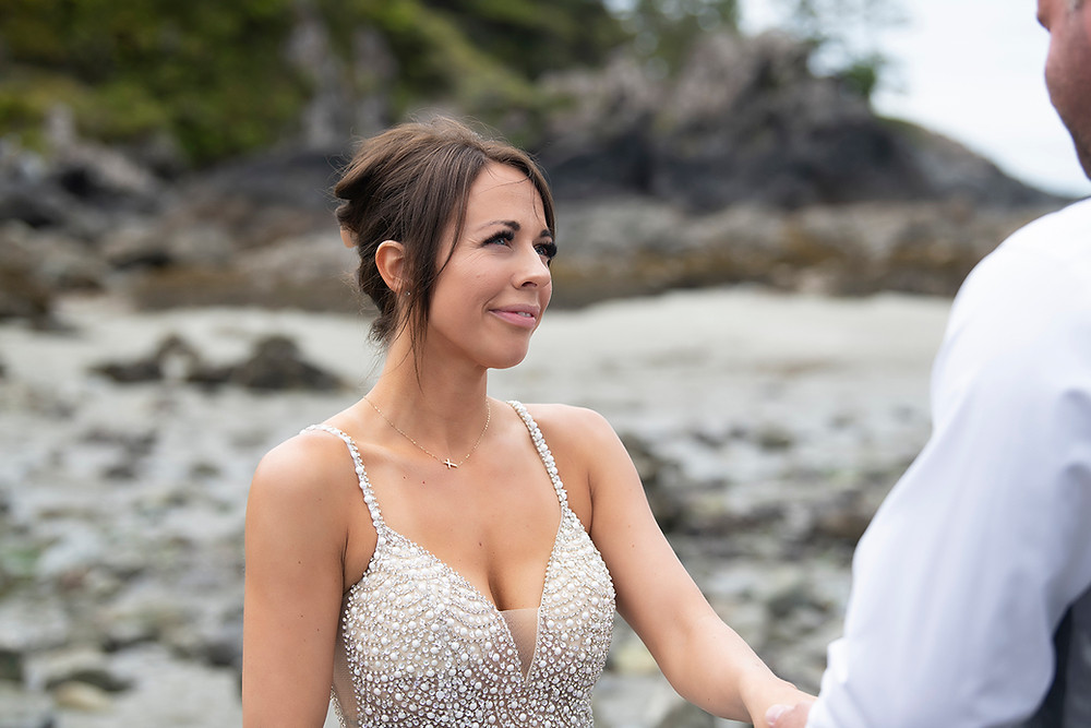 Smiling bride at at elopement in Tofino. Photographed by Kaitlyn Shea.