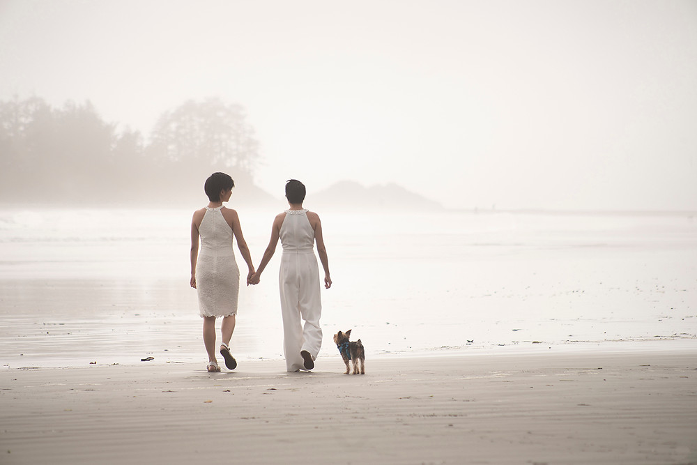 happy couple and their dog at destination wedding in Tofino. Photographed by Kaitlyn Shea.