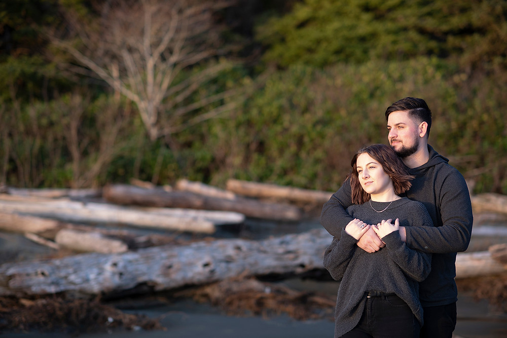 Man holds his fiancé during their Tofino engagement photos. Photographed by Tofino photographer Kaitlyn Shea.