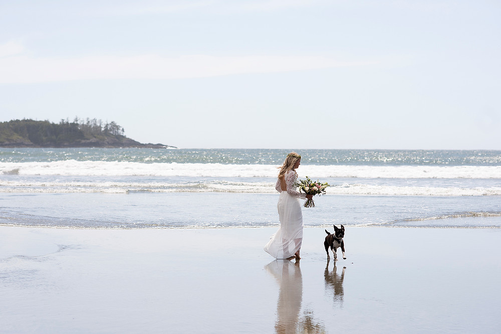 Bride and her dog at Tofino beach wedding. Photographed by Kaitlyn Shea