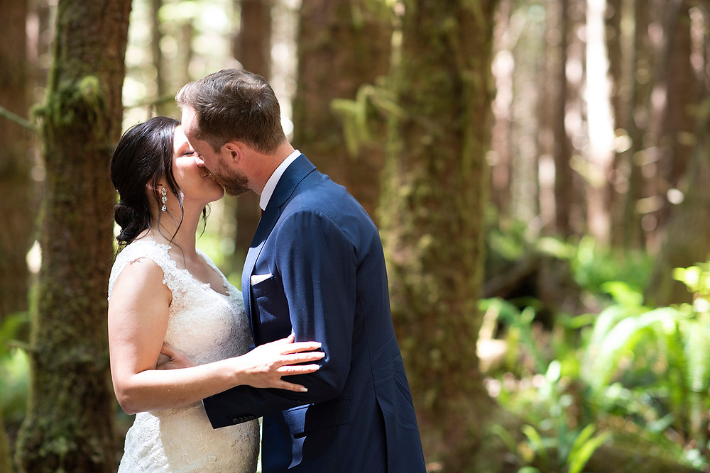 First kiss at a forest wedding in Tofino.