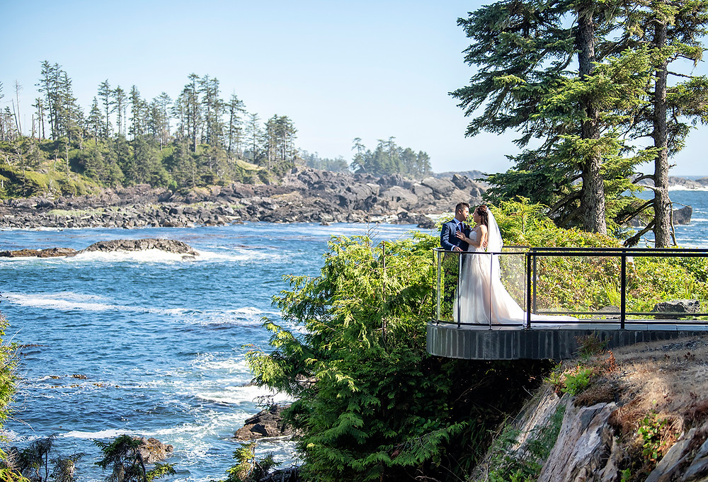 Bride and groom hold each other with ocean in the background at their Ucluelet wedding at Black Rock Resort. Photographed by Ucluelet Photographer Kaitlyn Shea.