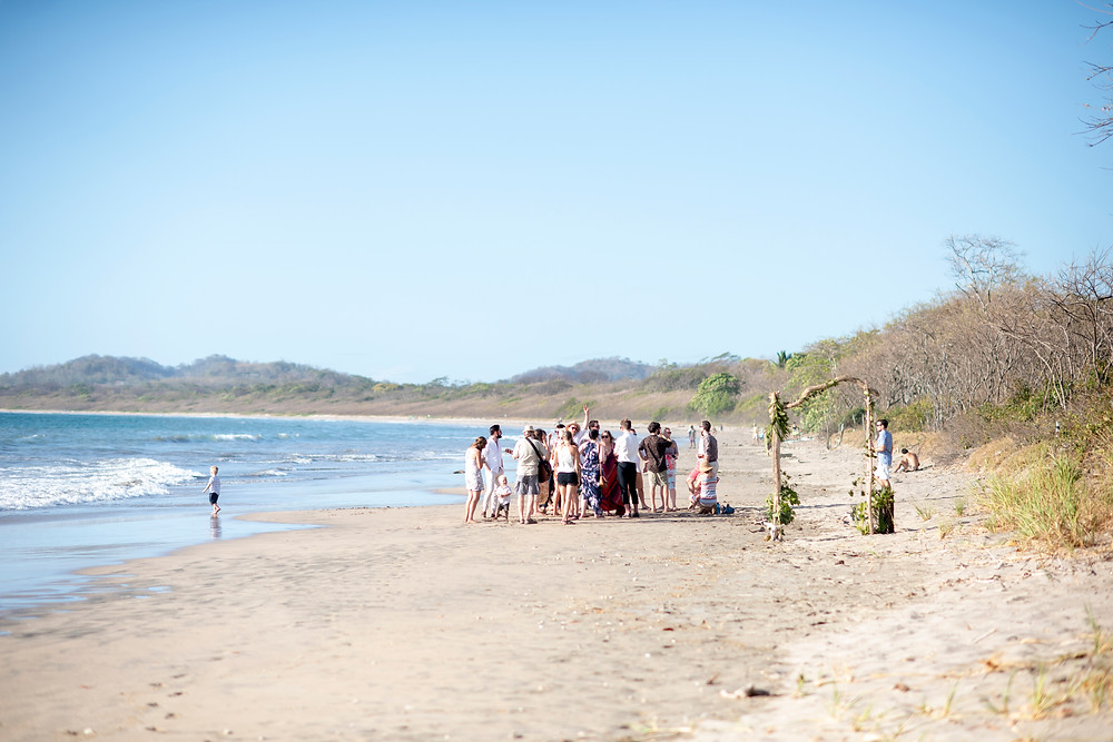Guests wait for ceremony to start at a destination wedding in Playa Grande, Costa Rica. Photographed by Kaitlyn Shea.