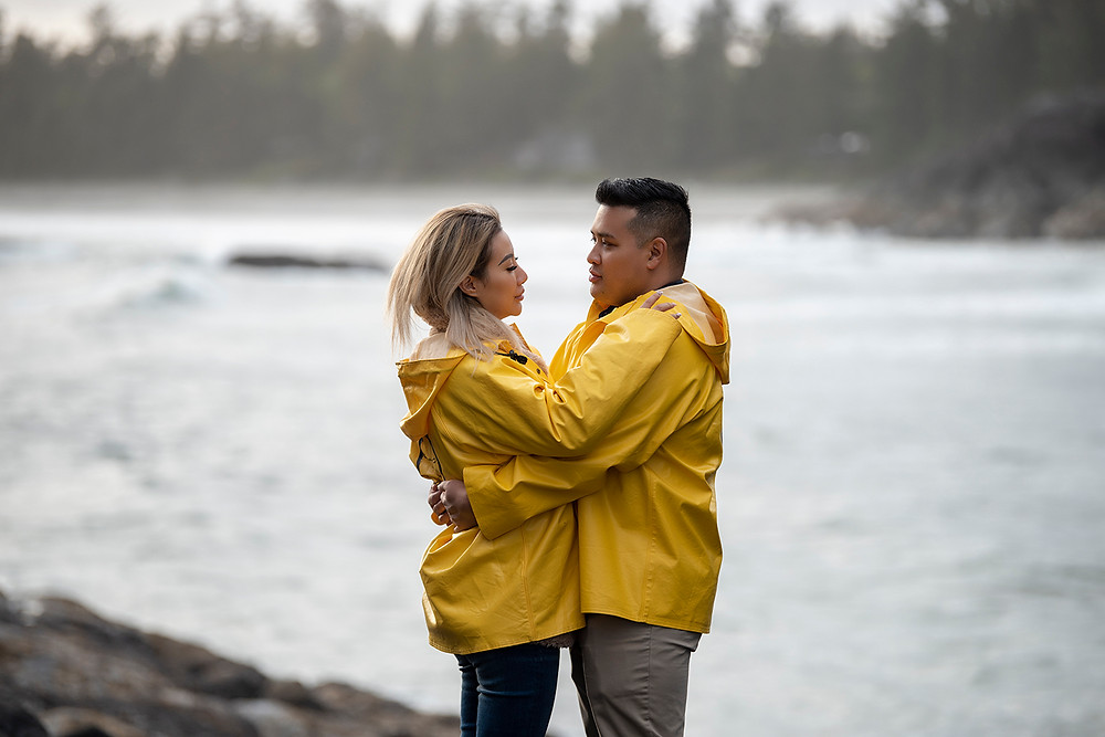 Man and woman hug after getting engaged in Tofino. Photographed by Kaitlyn Shea.