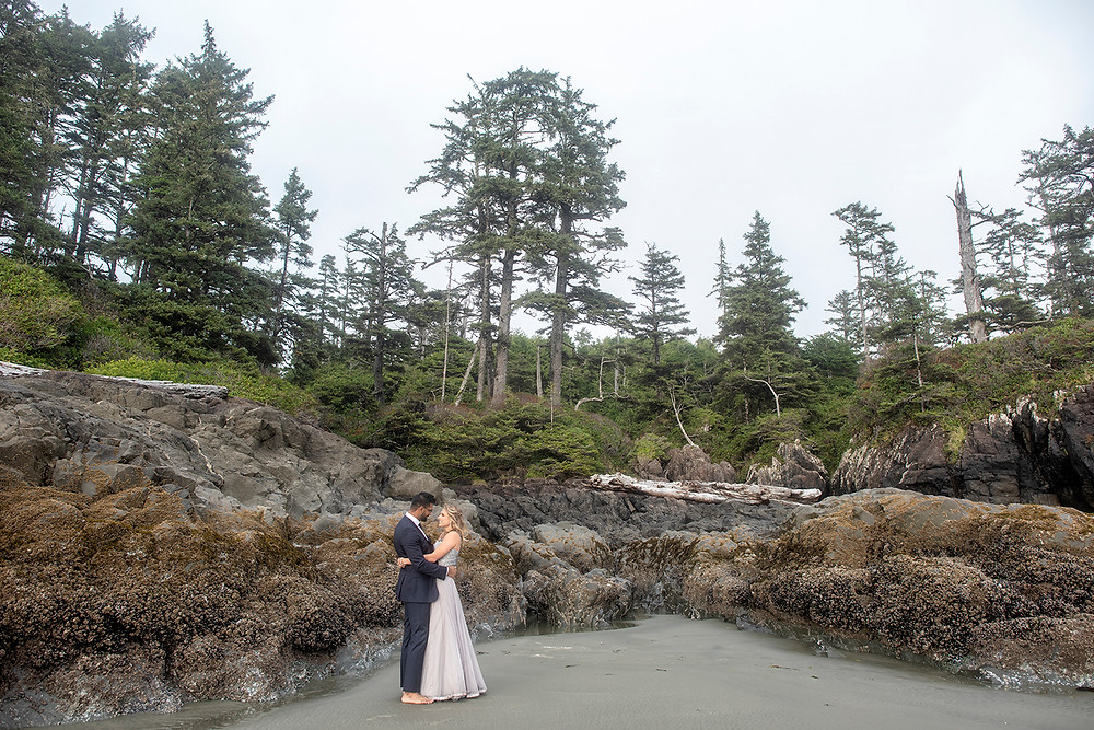 Couple embraces at their small wedding in Tofino. Photographed by Tofino wedding photographer Kaitlyn Shea.