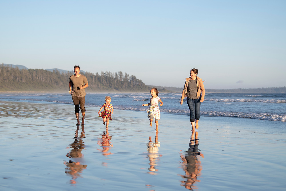 Family walks on Long Beach in Tofino during their family photography session. Photographed by Kaitlyn Shea.
