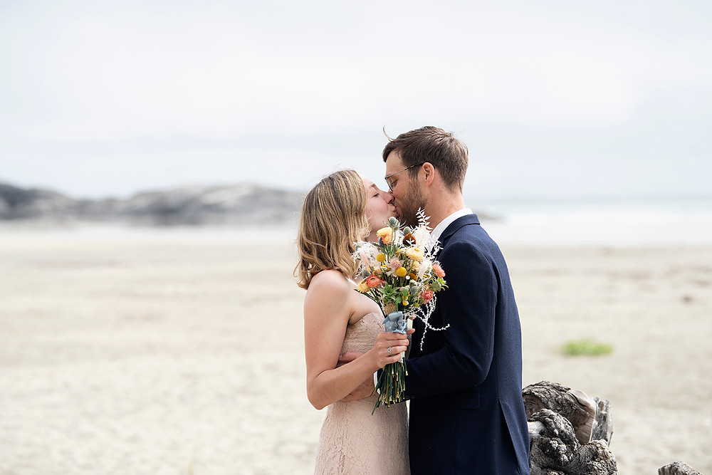 First kiss as a married couple at elopement in Tofino. Photographed by Kaitlyn Shea.