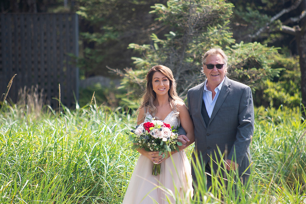 father leads bride down the aisle at Long Beach Lodge wedding in Tofino. Photographed by Kaitlyn Shea