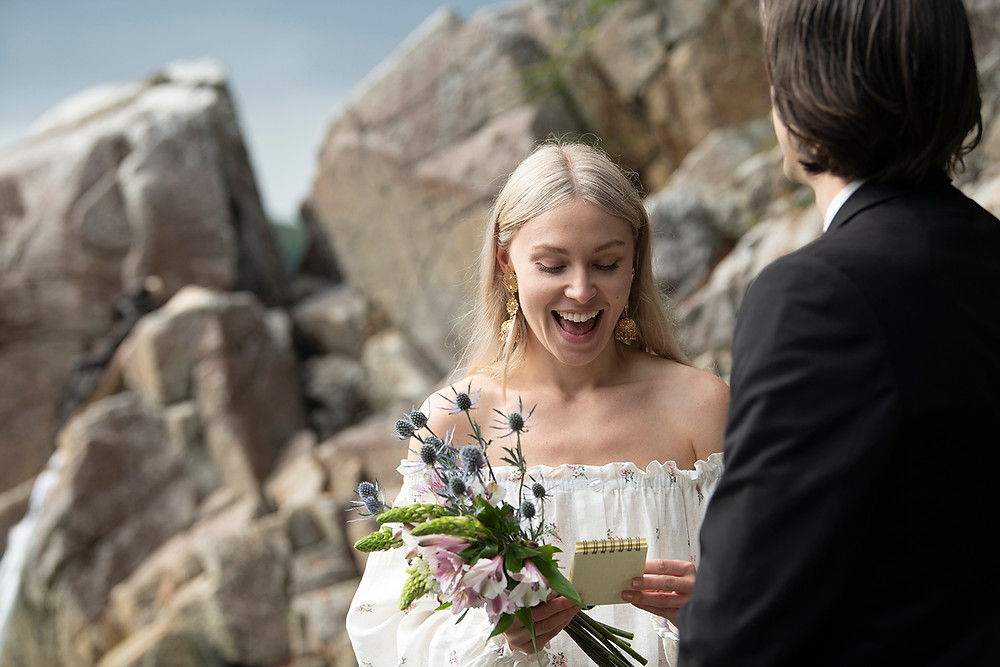 Bride reads her handwritten vows at a Tofino wedding at Tonquin Beach. Photographed by Tofino wedding photographer Kaitlyn Shea.