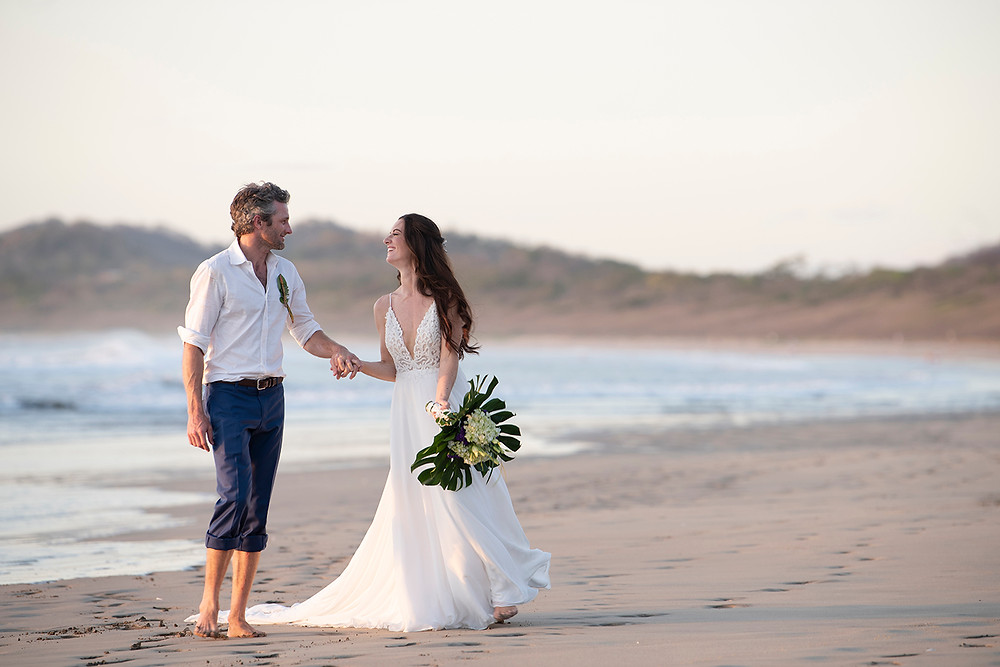 Couple jokes around during their destination wedding in Playa Grande, Costa Rica. Photographed by Kaitlyn Shea.