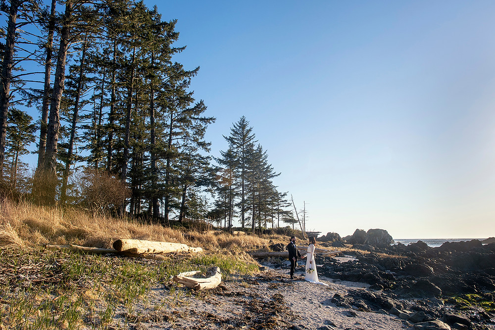 Bride and groom at their elopement in Ucluelet, surrounded by stunning scenery. Photographed by Kaitlyn Shea.