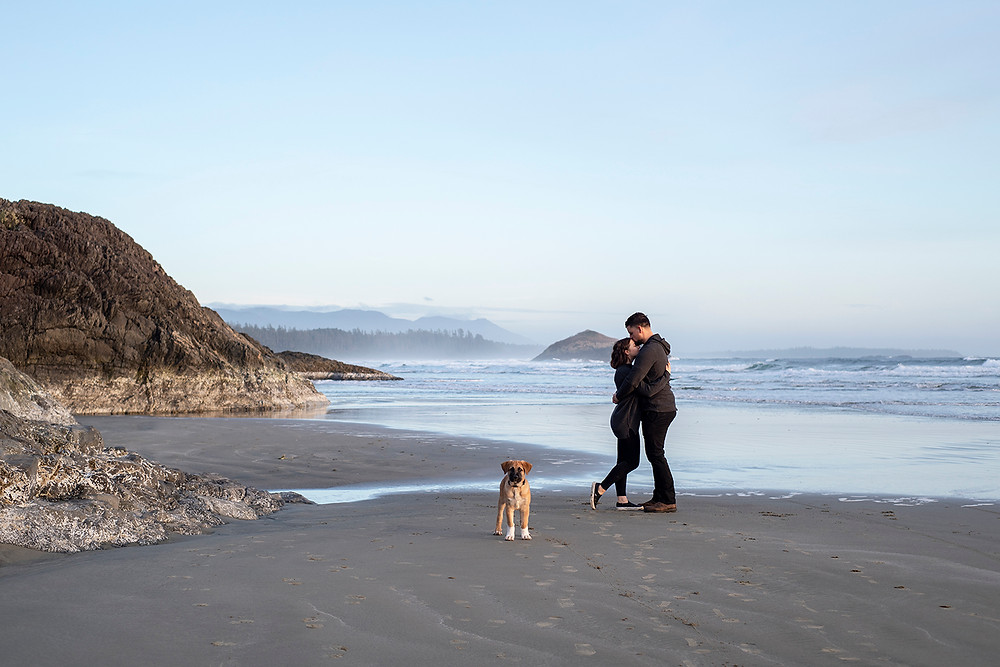 Happy couple holds each other during their Tofino engagement photos. Photographed by Tofino photographer Kaitlyn Shea.