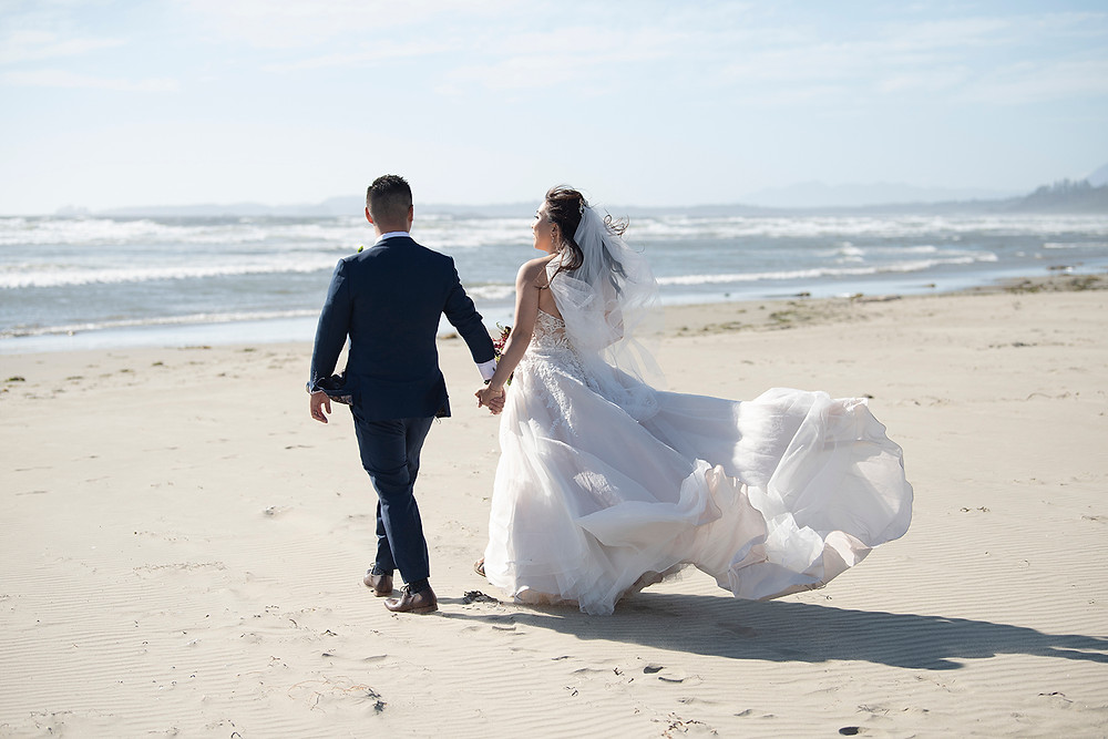 Bride dress flows in the wind at her Ucluelet wedding at Black Rock Resort. Photographed by Ucluelet Photographer Kaitlyn Shea.