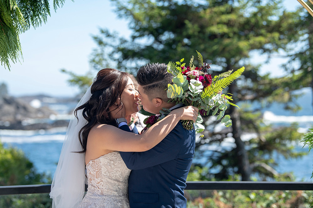 Couple has their first kiss at their Ucluelet wedding at Black Rock Resort. Photographed by Ucluelet Photographer Kaitlyn Shea.