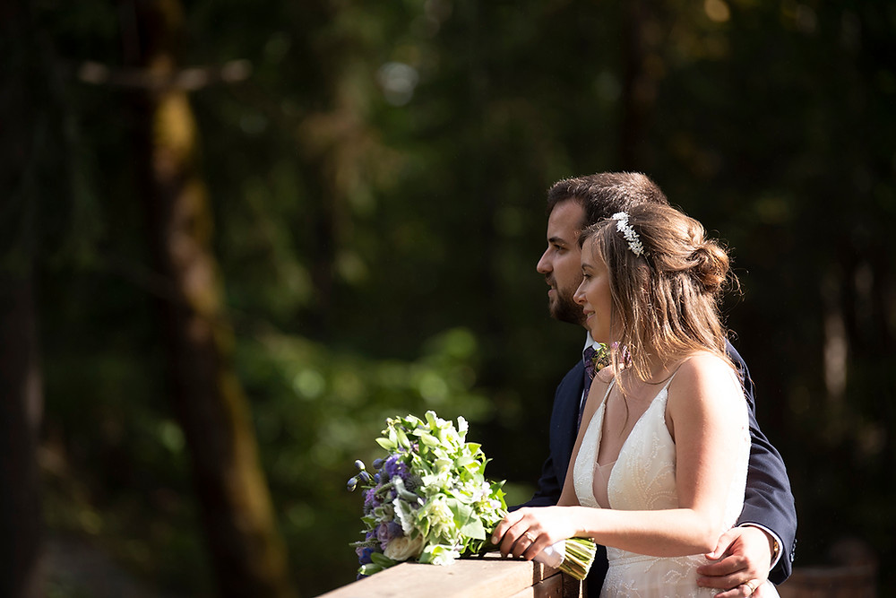Groom wraps arm around his bride at their August wedding on Vancouver Island. Photographed by Kaitlyn Shea.
