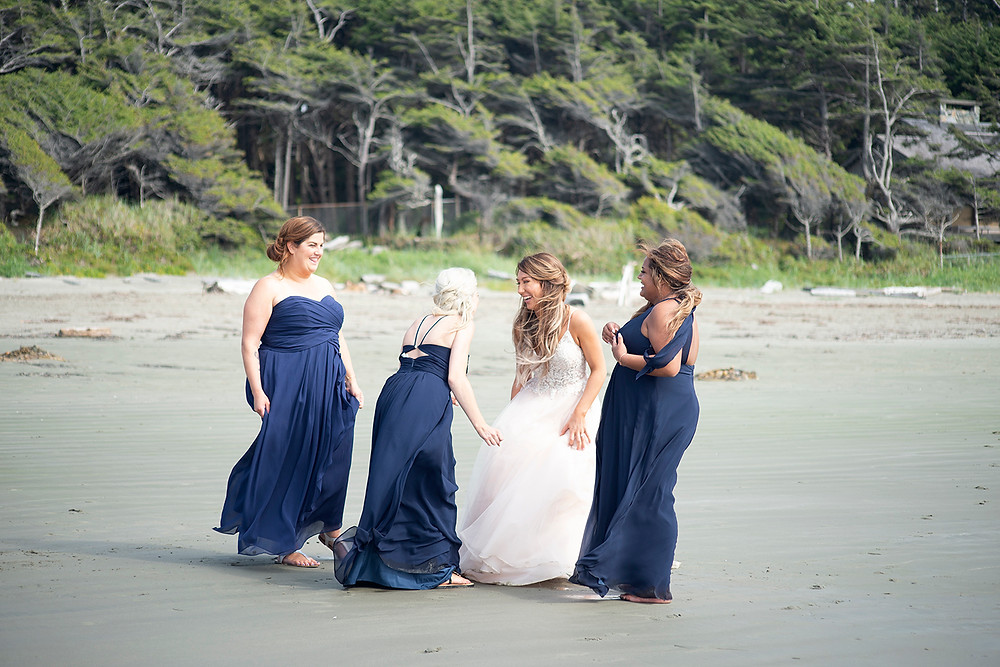 bridesmaids laugh at Tofino beach wedding. Photographed by Kaitlyn Shea