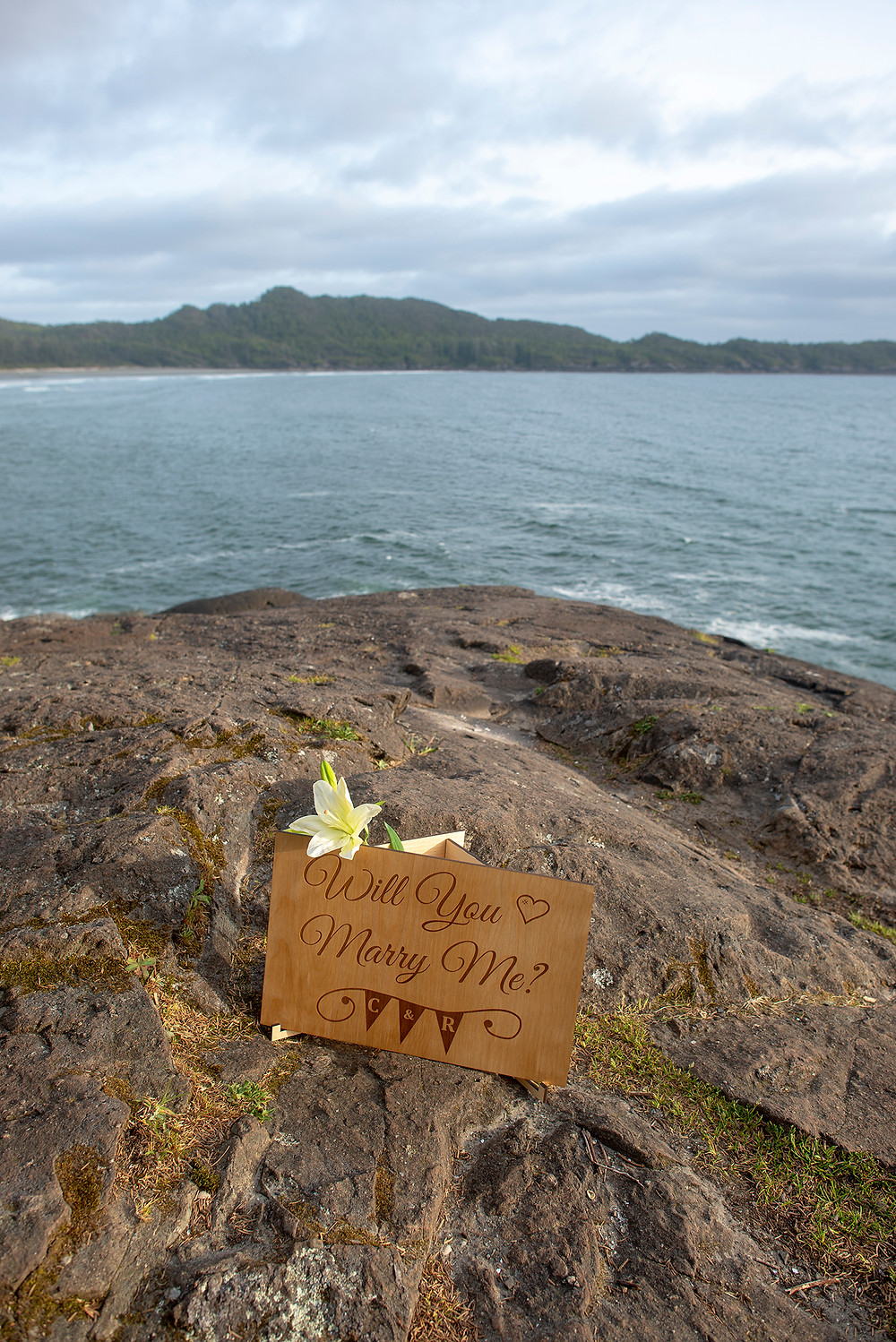 Surprise proposal on Cox Bay in Tofino. Photographed by Kaitlyn Shea.