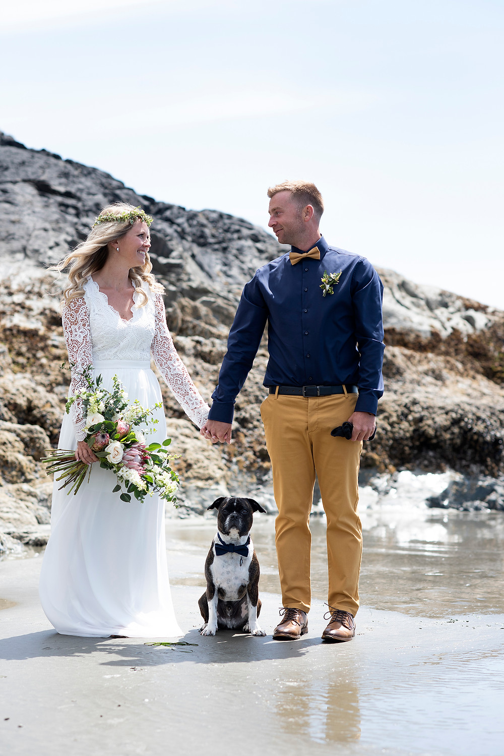 bride and groom with dog at Chesterman Beach wedding in Tofino. Photographed by Kaitlyn Shea