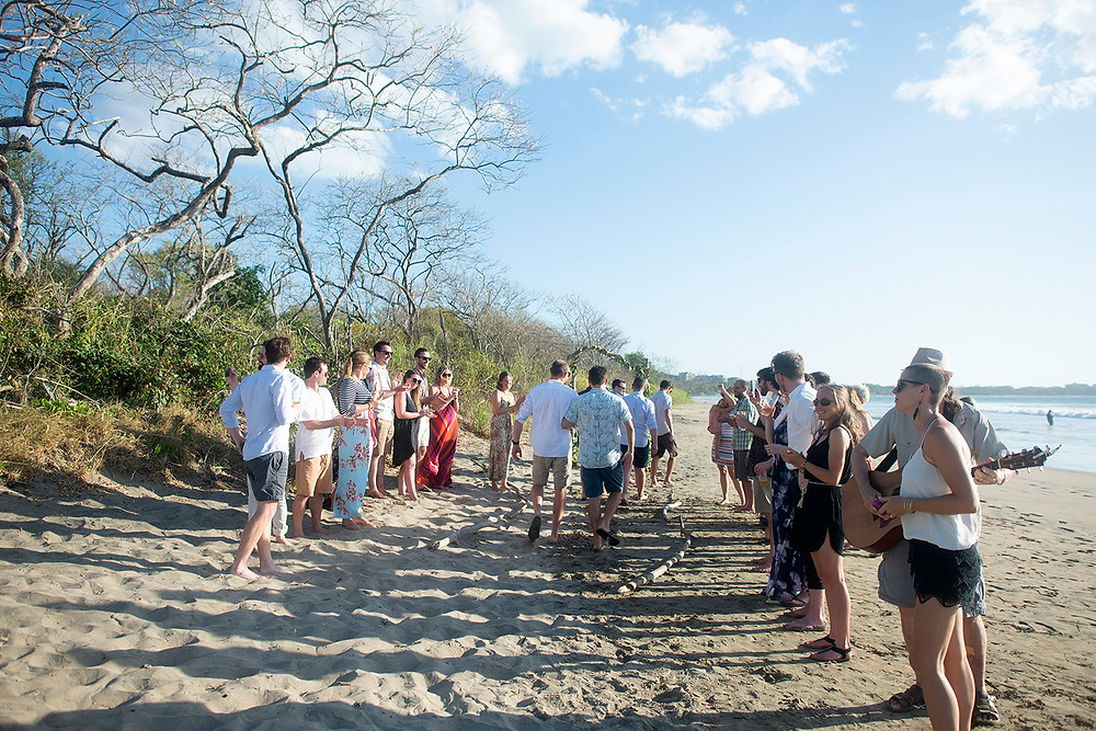 Ceremony at destination wedding in Playa Grande, Costa Rica. Photographed by Kaitlyn Shea.