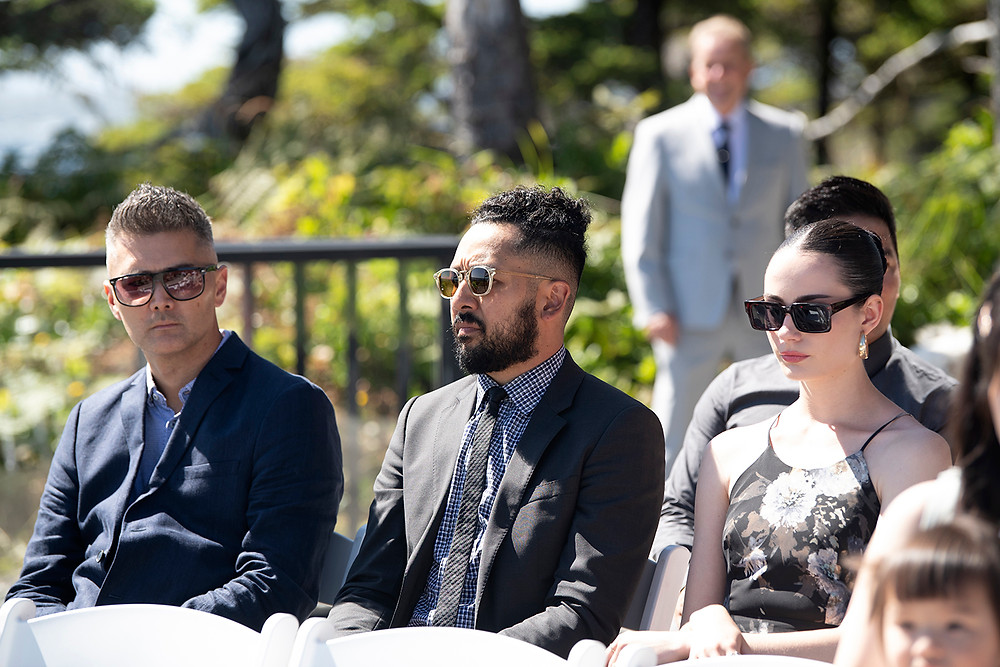 Wedding guests wait for ceremony to start at a Ucluelet wedding at Black Rock Resort. Photographed by Ucluelet Photographer Kaitlyn Shea.