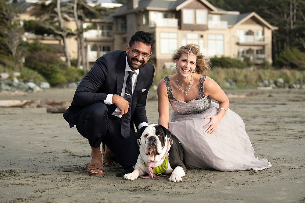 Bride and grrom pose with their dog at their small wedding in Tofino. Photographed by Tofino wedding photographer Kaitlyn Shea.