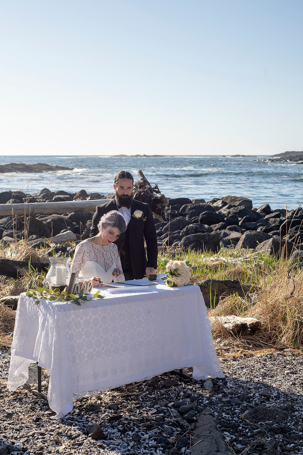 Bride signs marriage at her Ucluelet Elopement. Photographed by Kaitlyn Shea.