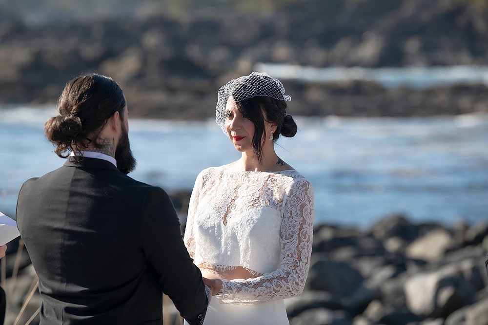 Bride says her vows while eloping in Ucluelet. Photographed by Kaitlyn Shea.
