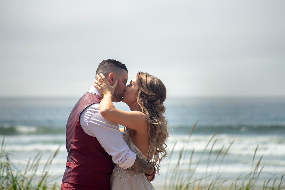first kiss as man and wife at beach wedding in Tofino. Photographed by Kaitlyn Shea